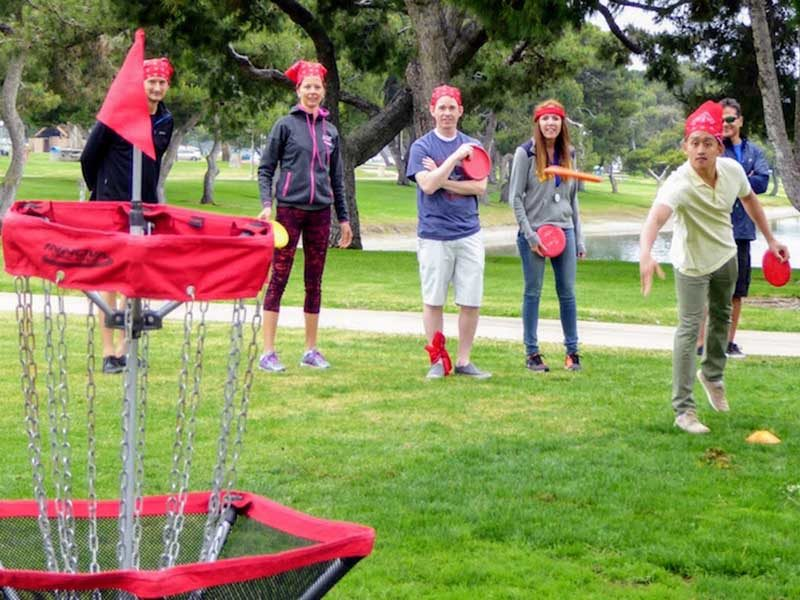 Leisure Olymics team-building games includes Disc Golf which is also known as Frisbee golf | Out of the Ordinary Group and Team Adventures